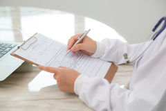 Hand of doctor writing Royalty Free Stock Photography
