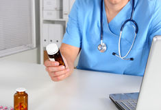 Hand of doctors holding many different pills.  Royalty Free Stock Photos
