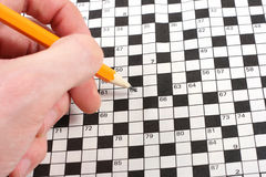 Hand doing crossword Stock Photography