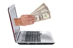 Hand with dollar banknotes comes from the laptop screen Stock Images