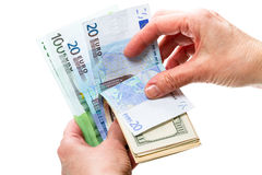 Hand with dollar and euro. Hand count the dollars and euro isolated on white background Stock Photography