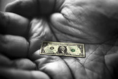 Hand with dollar note stock image