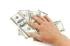 Hand on dollars Royalty Free Stock Images