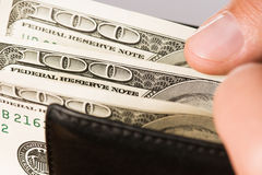 Hand with dollars Stock Photos