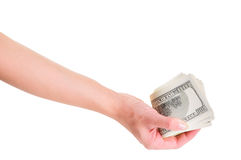 Hand with dollars Stock Images