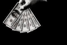 Hand with dollars over black Stock Photography