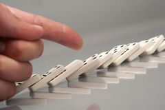 Hand with domino Royalty Free Stock Photos