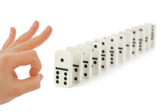 Hand and domino Royalty Free Stock Photo