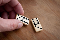 Hand with domino. Stock Photography