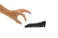 Hand and dominoes Royalty Free Stock Image
