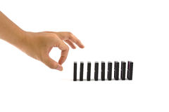 Hand and dominoes Stock Photography