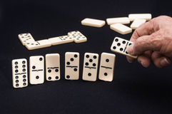 A hand of dominoes Stock Images