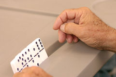 A hand of Dominos. Close-up of the hands of an old man playing Dominos at the park Royalty Free Stock Photos