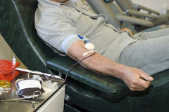Hand of the donor. With a medical needle in a vein stock images
