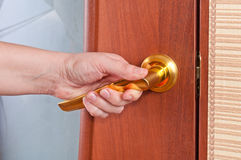 Hand and the door handle Royalty Free Stock Photo