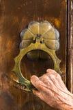 Hand on door handle Royalty Free Stock Photo
