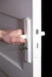 Hand and door. Stock Photos