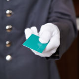 Hand of doorman giving key card Stock Photography