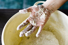 Hand with dough Royalty Free Stock Photo