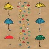 Hand dragen uppsättning av färgrika paraplyer Arkivbild