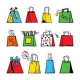 Hand-dragen uppsättning av stiliserade färgrika shoppa påsar och etiketter på en vit bakgrund royaltyfri illustrationer