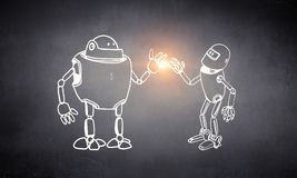 Hand dran robot. Funny childish drawn robot on concrete background Royalty Free Stock Photography