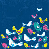 Hand draw birds on grunge blue background Stock Images