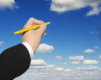 Hand draw on the blue sky. Royalty Free Stock Photography