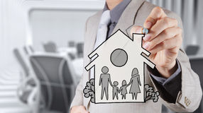 Hand draw family and house as insurance. Concept stock photos