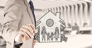 Hand draw family and house as insurance. Concept stock photo