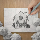 Hand draw family and house as insurance. Hand draw family and house on crumpled paper as insurance concept royalty free stock photography