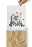 Hand draw family and house. On crumpled paper as insurance concept stock photography