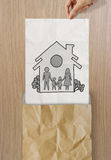 Hand draw family and house. On crumpled paper as insurance concept stock images