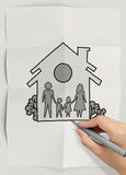 Hand draw family and house. On crumpled paper as insurance concept royalty free stock image