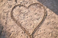 Hand draw heart on the beach sand stock photos