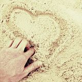 Hand draw heart in the sand on the coast Royalty Free Stock Photography