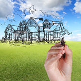 Hand draw house against blue sky Royalty Free Stock Images