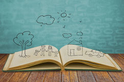 Hand draw in open book of lovely family complete Royalty Free Stock Image
