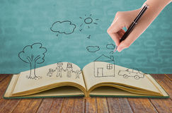 Hand draw in open book of lovely family imagination Royalty Free Stock Photography