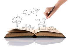 Hand draw in open book of lovely family. Over white background Royalty Free Stock Photos