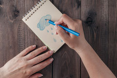 Hand draw at rainny on notebook Royalty Free Stock Images