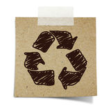 Hand draw recycle sign on recycle paper. Hand draw recycle sign on note taped recycle paper Royalty Free Stock Images