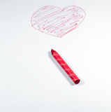 A Hand draw by red crayon, heart shape isolated on white backgroun Royalty Free Stock Image
