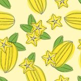 Hand draw seamless pettern with star fruit carambola on yellow background. royalty free illustration