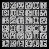 Hand draw sketch doodle alphabet design on black Stock Images