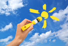 Hand draw the sun in sky Stock Photos
