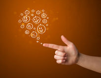 Hand drawed smiley faces coming out of gun shaped hands. Group of happy hand drawed smiley faces coming out of gun shaped hands Royalty Free Stock Image