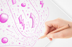 Hand drawing abstract sketches and doodles on paper. Hand drawing abstract sketches on a plain white paper Stock Photo