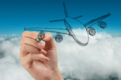 Hand drawing airplane on blue sky Stock Photo