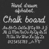 Hand drawing alphabet abc font on. Hand alphabet abc font on blackboard. Italic light thin line type letters, numbers and punctuation marks Stock Photo